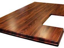 African Mahogany Island top with Walnut Stain.  Edge Grain construction with book-matched drop edges.