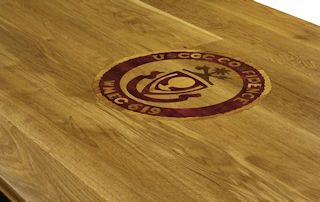 Custom Purpleheart, Walnut and White Oak inlay set into a Face Grain White Oak table top.
