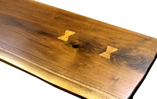 Pecan butterfly inlays in Texas Walnut table top.