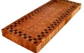 End Grain Cherry Island Top with a patterned Walnut Accent Band.