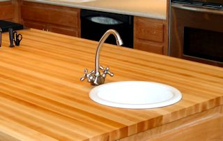 Edge Grain Hard Maple Island Top with drop in sink and Waterlox finish