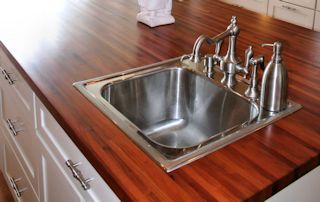 Edge Grain Mesquite Island Top with drop in sink and Waterlox finish