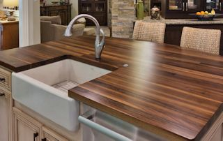Edge Grain Walnut Island Top with farm sink and Waterlox finish