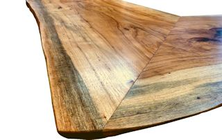 Custom desk top constructed using book-matched Pecan slabs. Natural edges and Waterlox satin finish