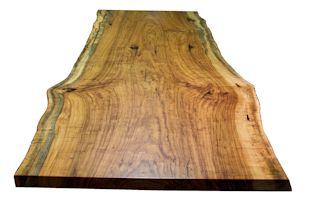 Custom table top constructed from a large Texas Pecan slab. Natural edges and Waterlox satin finish