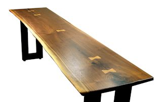 Custom Walnut slab table top with maple butterfly inlays. Natural edges and Waterlox satin finish