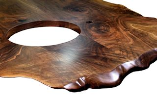 Custom Walnut island top from two book-matched slabs. Sculpted wane edges and Waterlox satin finish