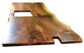 Custom Walnut island top from two book-matched slabs. Natural wane edges and Waterlox satin finish