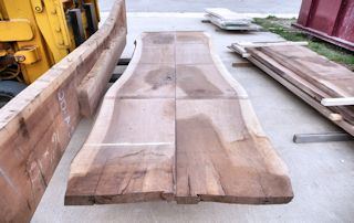 A matched pair of Walnut slabs with one straight edge.