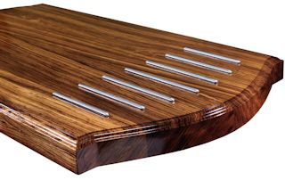 Zebrawood Island Top with Integrated Trivet made using Rounded Stainless Steel Bars.