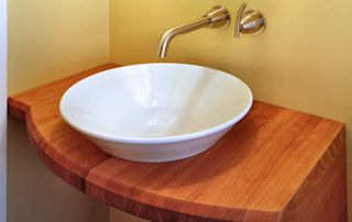 Edge Grain Cherry Vanity with vessel sink and Waterlox finish
