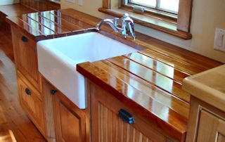 Edge Grain Cherry Countertop with farm sink and Waterlox finish