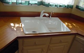 Edge Grain Cherry countertop with drop in sink and Waterlox finish