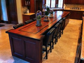Jatoba face grain wood island countertop with wenge inlay and banding.