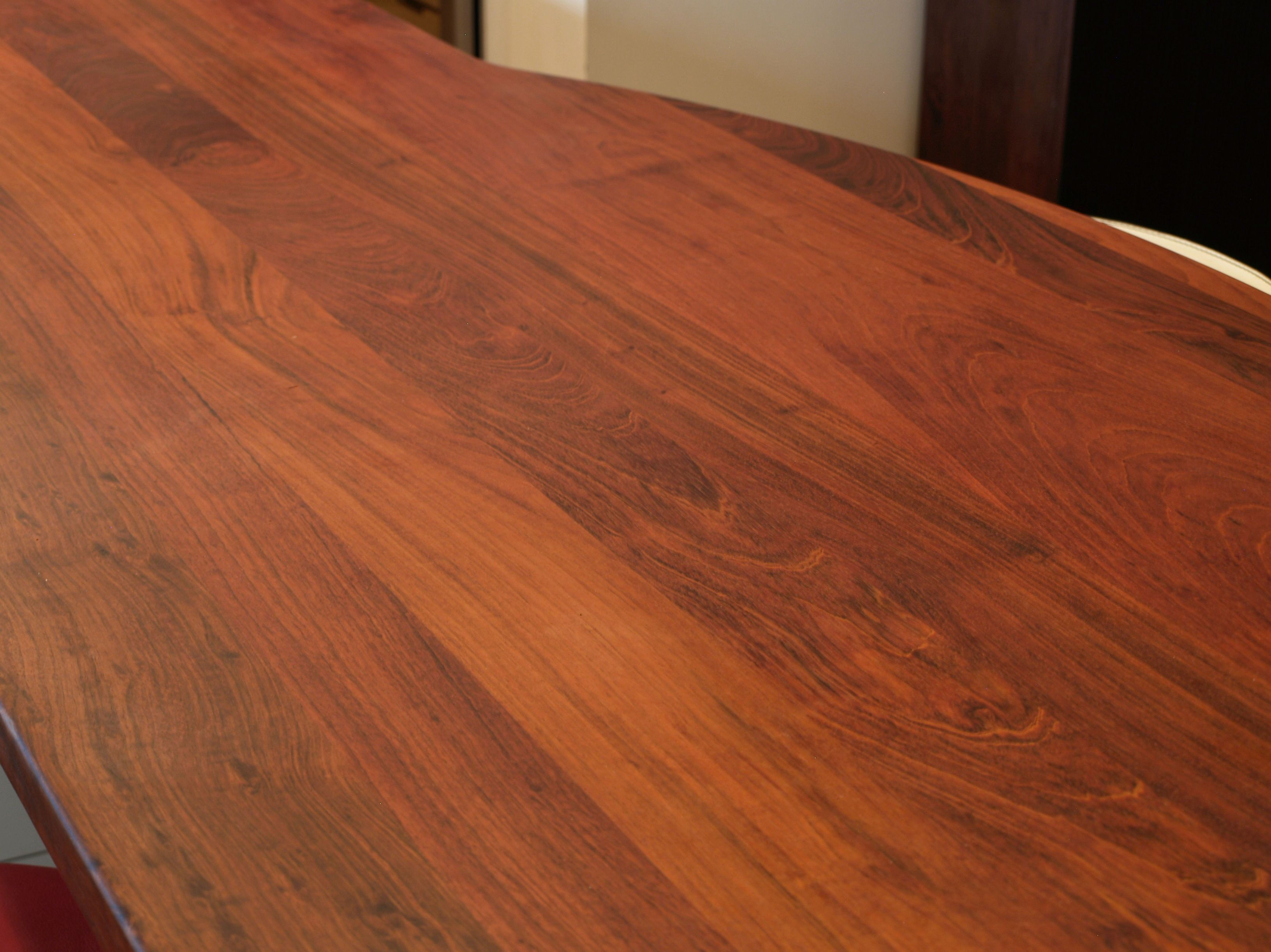 Jatoba face grain island countertop with Tung Oil Citrus finish.  Custom metal base designed by DeVos Custom Woodworking.