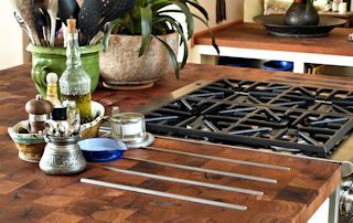 Mesquite Parquet-Style Island Top with Integrated Trivet using Stainless Steel Bars.