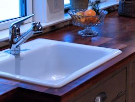 Edge Grain Mesquite Countertop with drop in sink and Waterlox finish