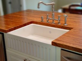 Edge Grain Mesquite Island Top with farm sink and Waterlox finish