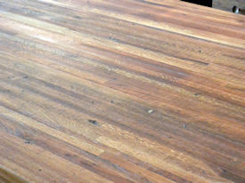 Reclaimed Boxcar Flooring edge grain wood island countertop with Tung-Oil finish.