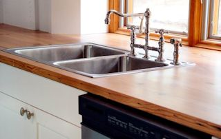Face Grain Reclaimed Longleaf Pine countertop with drop in sink and Waterlox finish