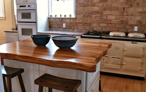 Face Grain Reclaimed Longleaf Pine Wood Island Countertop with Wane Edges