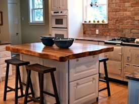 Reclaimed Longleaf Pine face grain custom wood island countertop.