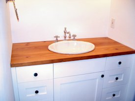 Reclaimed Longleaf Pine face grain custom wood desk top.