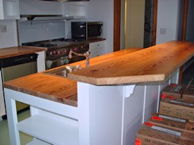 Reclaimed Longleaf Pine face grain custom wood counter top and bar top.