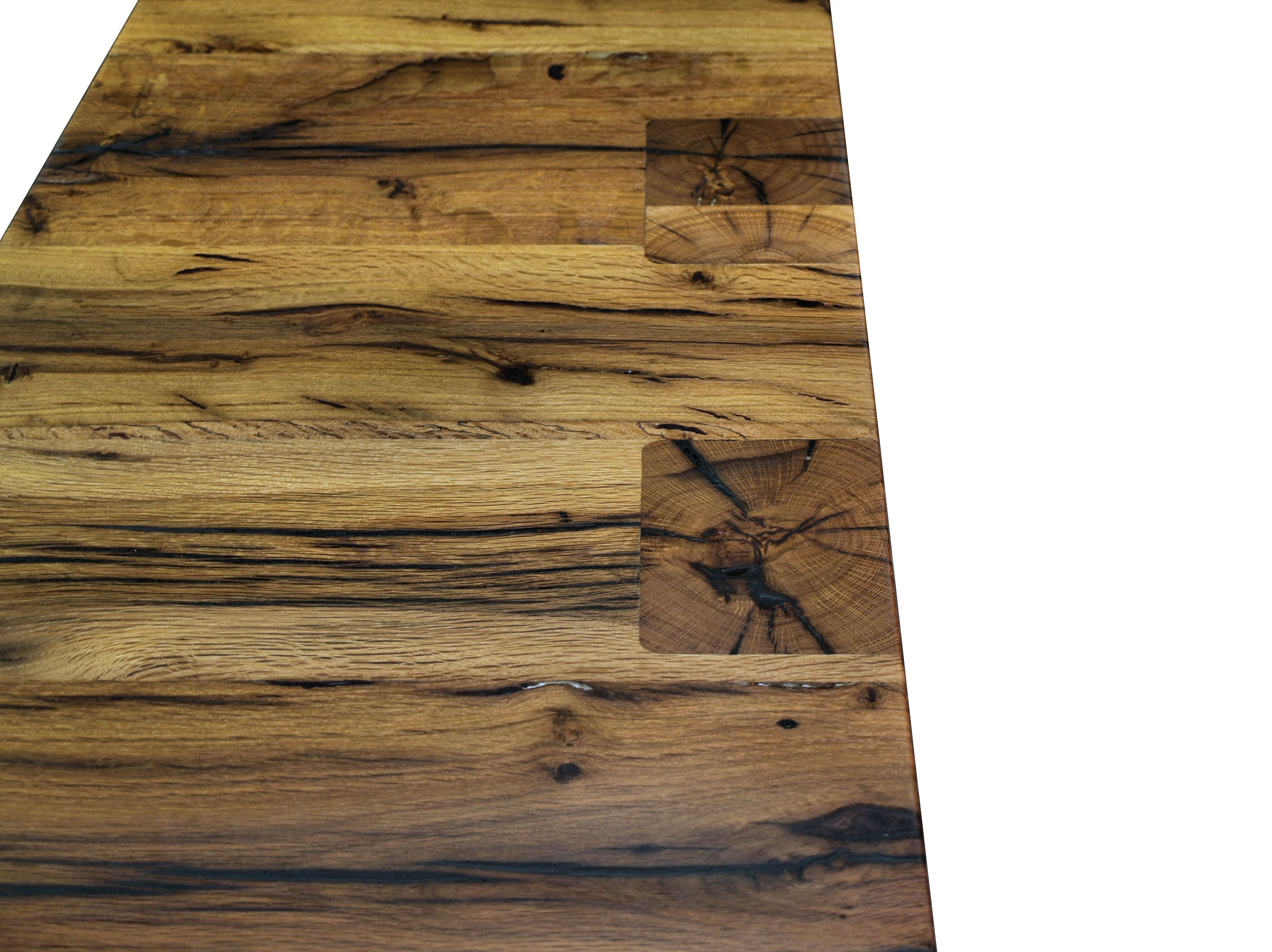 Contemporary Reclaimed White Oak custom wood island with DeVos Puzzle Joint along the length.  Finger Joint ends with Waterfall return to the floor and Tung-Oil finish.