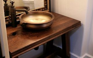 Face Grain Walnut Vanity with vessel sink and Waterlox finish