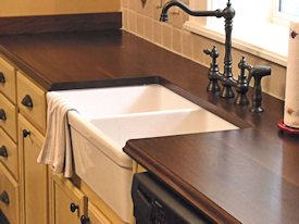 Face Grain Walnut Countertop with farm sink and Waterlox finish
