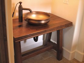 Walnut face grain reproduction wood vanity top and base.