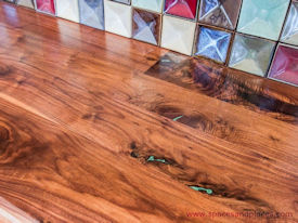 Rustic Walnut face grain countertop with Turquoise Fills and Waterlox Satin finish.