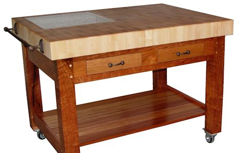 Custom Mesquite chef''s table (36x48x36) with mortise and tenon jointery and an end grain 4 inch thick Hard Maple chopping block.  Contains Pecan drawer fronts, african mahogany shelf and an 18x18 granite insert.