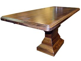 Custom distressed walnut table with pedestal-style base.