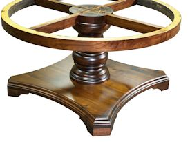 Custom round walnut table with turned pedestal-style base