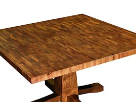 Custom table with walnut pedestal-style base and mesquite end-grain top