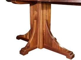 Custom distressed walnut table with pedestal-style base