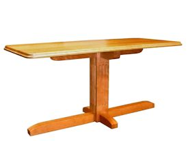 Custom cherry table with fluted pedestal-style base