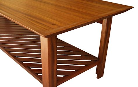Custom Jatoba vanity table with carved top and slat-style shelf