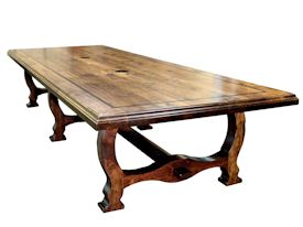 Custom distressed face grain Walnut trestle-style conference table with Wenge accents.  Pop-up electrical grommet access.  Through mortise and tenon jointery.