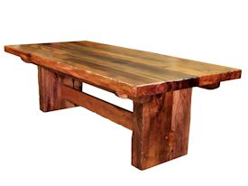 Custom face grain argentinean mesquite dining table.  Rustic trestle-style construction with through mortise and tenon jointery and hand carved edges.