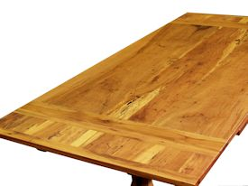 Custom trestle style dining table with self-storing leaves.  Made from spalted pecan with bread board ends and mortise and tenon jointery.