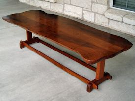 Custom mesquite coffee table with mahogany trestle style base.