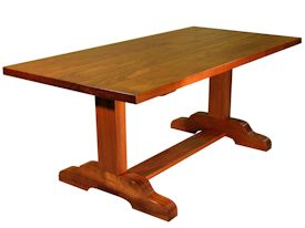 Custom Jatoba trestle style dining table with mortise and tenon jointery.