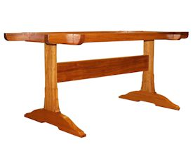 Custom face grain Jatoba trestle-style table with mortise and tenon jointery.