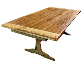 Custom spalted pecan trestle-style table with self storing leaves.  Face grain construction with bread board ends.