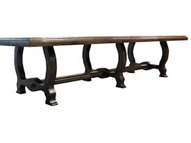Distressed face grain Walnut trestle-style dining table with mortise and tenon jointery.