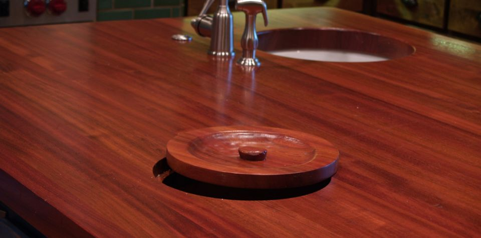 Jatoba Wood Island Countertop with Integrated Trash Hole and Hand Carved Trash Lid
